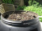 Compost tumbler brimming full