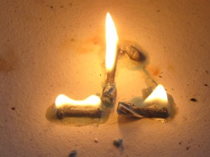 Yes, it is possible to burn a candle at three ends.